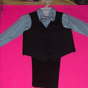 A baby boys four piece suit with bowtie